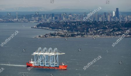 Container cranes passes through Puget Sound, Seattle