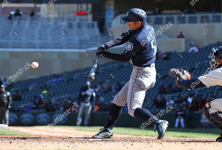 Seattle Mariners' Ichiro Suzuki of Japan singles off Minnesota Twins  pitcher Ryan Pressly in the ...